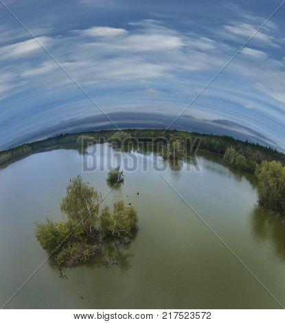 pond and blue sky - aerial view