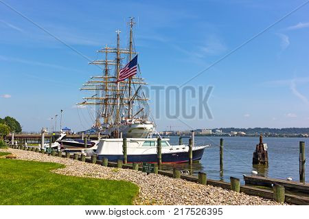 ALEXANDRIA VIRGINIA USA - SEPTEMBER 4 2017: U.S. Coast Guard tall ship docked in Virginia USA. The Cutter Eagle visits cities along USA East Coast for free public tours.