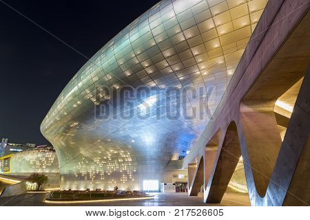 SEOUL, SOUTH KOREA - APRIL 19: Futuristic architecture of Dongdaemun Design Plaza (DDP) in Seoul, South Korea at night on April 19, 2016 in Seoul, South Korea.