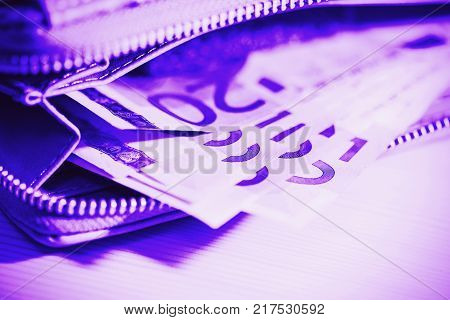 Euro banknotes in wallet. business finance investment saving and cash concept lose up of euro paper money
