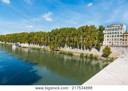 Tiber river under a blue sky. Rome Italy