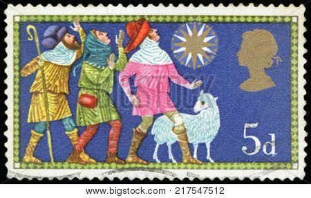 UNITED KINGDOM - CIRCA 1969: A stamp printed in the United Kingdom shows three shepherds and the Star of Bethlehem, Christmas, circa 1969