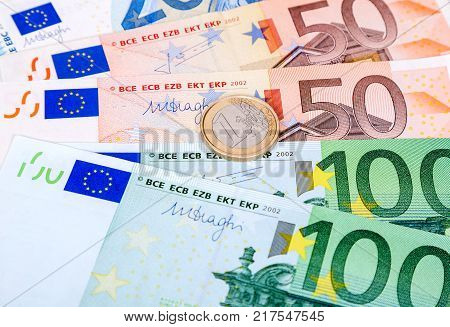 Coin One Euro Lying On A Euro Currency Banknotes