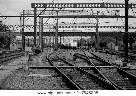 Bokeh grayscale shot of railway sidings in London