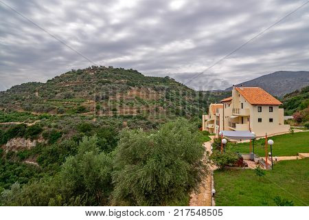 Mountain landscape and holiday villa under cloudy sky