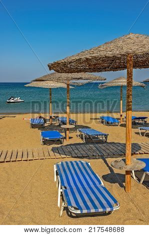 Resort sea beach with sunbeds and parasols