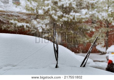 Windshield wiper of an snow covered car after heavy snowfall cars covered snow winter falls snow