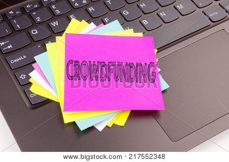 Writing Crowdfunding text made in the office close-up on laptop computer keyboard. Business concept for Business Fundraising Project Funding Workshop on the black background with space