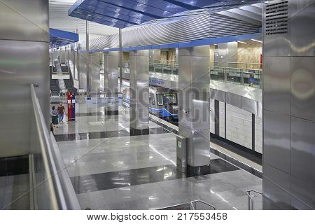 MOSCOW, AUG, 22, 2017: Metro station Business Center. Two levels floors metro station, blue train and train waiting people. Metallic railway station. New modern metro station metal architecture