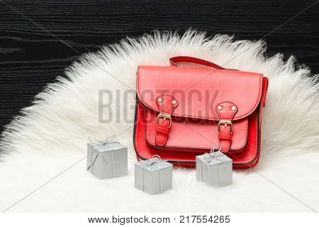 Red Bag And Mini Gift Box On White Fur. Fashionable Concept. Holiday Shopping