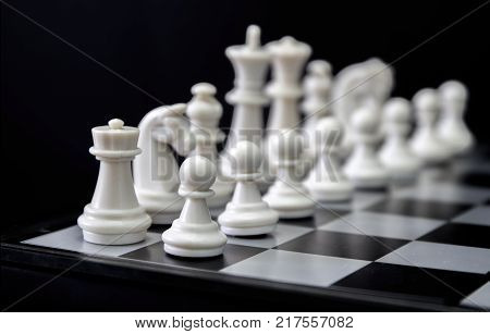 White chess figures on board. White chess set in order for game start. White chess figures row on checkered board. Chess figurine order. Checkmate game banner template. Intellectual sport. Tactic game