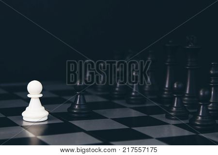 White pawn and black pawn on chess table. Black chess set in order for game start. Chess competition first move. Chess figurine order. Checkmate game banner template. Strategic opposition concept