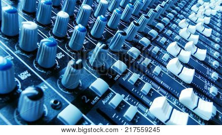 Audio mixer faders and knobs. Music production and sound engineering background. Dynamic composition.