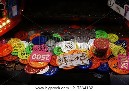BERLIN, GERMANY - DECEMBER 05: The close-up of Casino Ships as well as coins in a slot machine at a Christmas market on December 05, 2017 in Berlin.