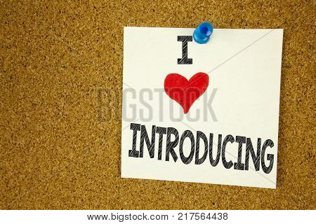 Hand writing text caption inspiration showing I Love Introducing concept meaning Introduction Start Intro Beginning Loving written on sticky note, reminder isolated background with space