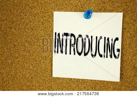 Conceptual hand writing text caption inspiration showing Introducing. Business concept for  Introduction Start Intro Beginning written on sticky note, reminder cork background with space