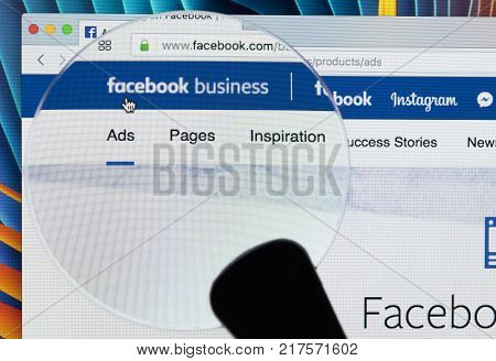Sankt-Petersburg Russia December 7 2017: Facebook business homepage website on Apple iMac monitor screen under magnifying glass. Facebook is the most popular social network in the world.