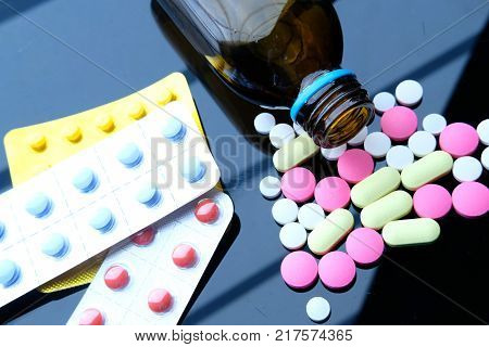 Pharmacy background on a wood table. Medicine and healthy. Close up of capsules. Different kind of medicines.