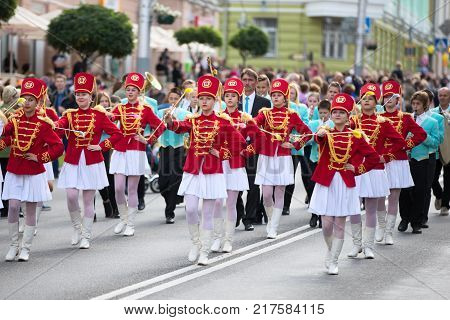 Belarus Gomel September 16 2017. Celebrating the city day.The city brass band is walking along the street. Street band in red bright clothes