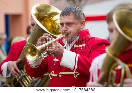 Belarus Gomel September 16 2017. Celebrating the city day.The musician is playing on the trumpet. A man participates in an orchestra. Trumpeter blows into the pipe