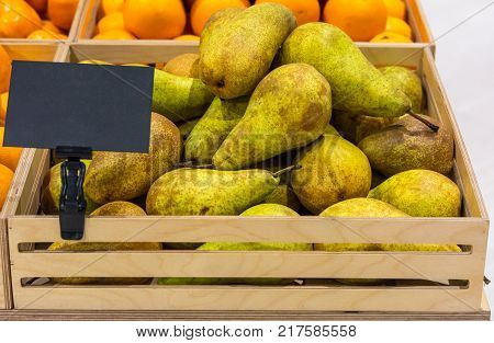 Conference pear varieties in a wooden box with a price tag