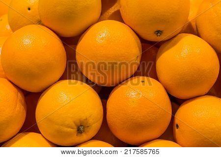 oranges as fruit background on store market .