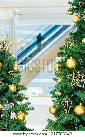 Christmas tree with gold decoration in shopping mall.Christmas clearance sales at the shopping mall.
