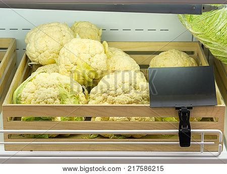 Cauliflower in a wooden box with a price tag
