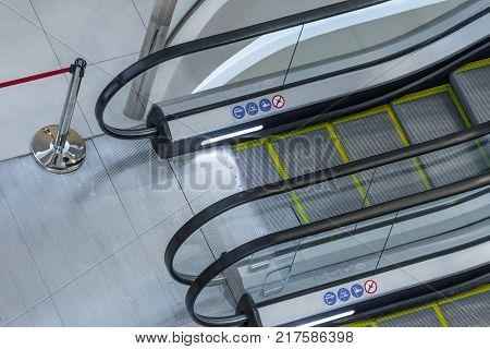 top view of escalators with detail signs of symbols