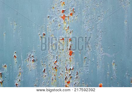 A Bluish Gray Background Of A Metal Panel With Oxidation Spots.
