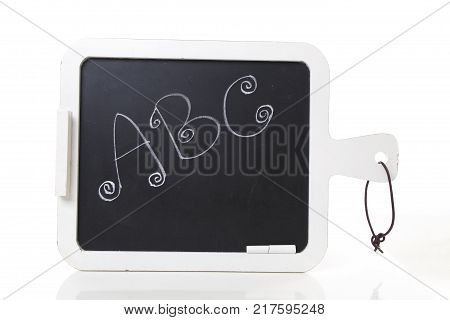 hand written ABC letters on a blackboard with chalk on it