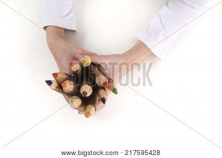 young woman holding a group of wooden colorful pencils