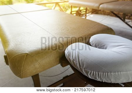 Spa massage room at wooden bungalow, beauty body care concept