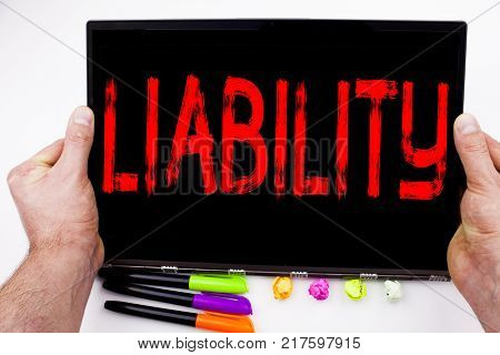 Liability text written on tablet, computer in the office with marker, pen, stationery. Business concept for Accountability Legal Blame Risk white background with space