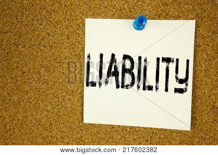 Conceptual hand writing text caption inspiration showing Liability. Business concept for  Accountability Legal Blame Risk written on sticky note, reminder cork background with space