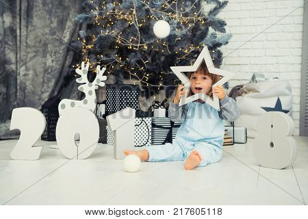Happy little star. New Year 2018, Christmas. Smiling funny two year old baby girl