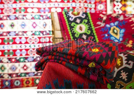 Chiprovtsi, Bulgaria - 24 July, 2017: Chiprovtsi Carpets (rugs). Traditional colorful carpets from Chiprovtsi region in Bulgaria. Hand-woven (hand-made) carpets with different elements and colours. Ethnic and folk patterns.