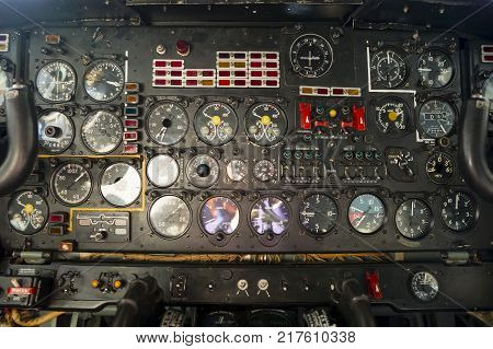 Flight desk control panel on an airplane designed for aerial cartography reconnaissance and transport. Old technology aircraft.