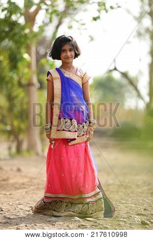 young happy indian child posing on saree