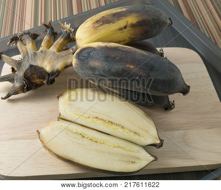 Fruits Black Rotten Wild Banana Asian Banana or Cultivated Banana on A Wooden Table.