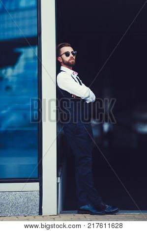 Men in full suit. Full length of confident young businessman standing outdoor