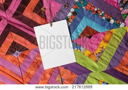 decoration, crafring, applied arts. most of the patches that create lovely blanket in popular technology called quilting, they are monochromic, but some has interesting design, there is card for text