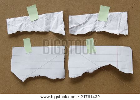 Collection Of Various White Note Papers On Brown Background.