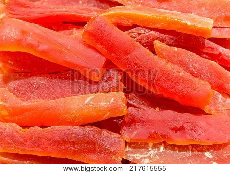 Dried slice pieces of ripe papaya in store