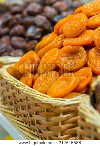 dried apricots in a basket on the counter oriental shop