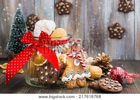 Mix of Christmas cookies - nuts, shortbreads, gingerbread cookies on wooden table with Christmas decor
