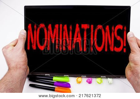 Nominations text written on tablet, computer in the office with marker, pen, stationery. Business concept for Election Nominate Nomination white background with space