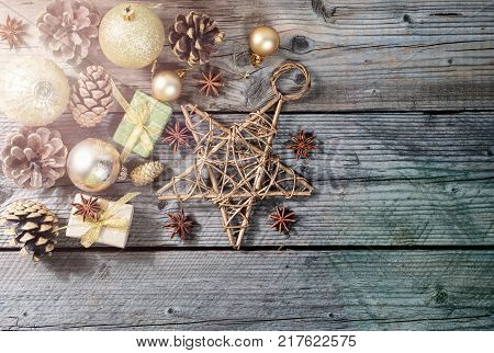 Christmas, New year holidays composition of decorations, cones and baubles on dark wooden background with copy space for your text design