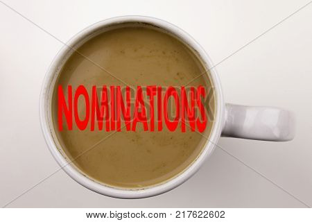 Word, writing Nominations text in coffee in cup. Business concept for Election Nominate Nomination on white background with space. Black text with red word.