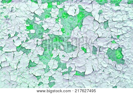 Green peeling paint on the old rough concrete surface - texture background. closeup of peeling paint texture on the old rough background. Peeling paint texture surface, texture background of green peeling paint